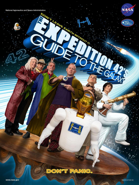 Locandina alternativa con le due crew delle expedition 41 e 42, nella riproduzione della locandina del film GUIDA GALATTICA PER AUTOSTOPPISTI.