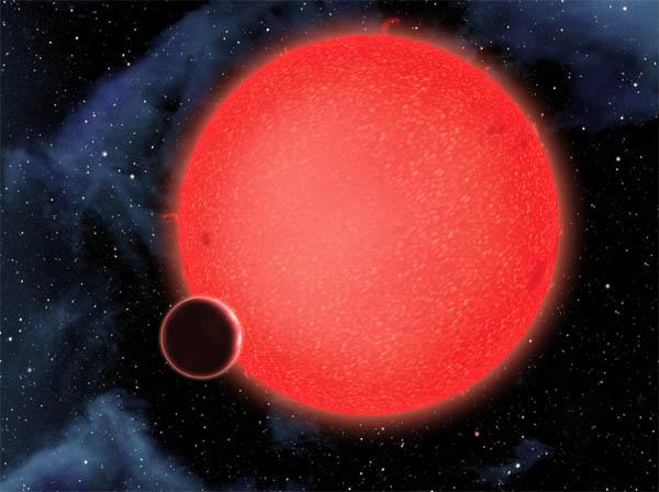 Visione artistica di un pianeta attorno a una nana rossa.